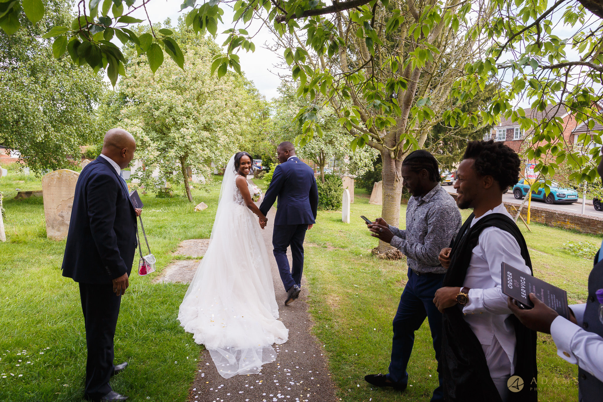 bride and groom walk away