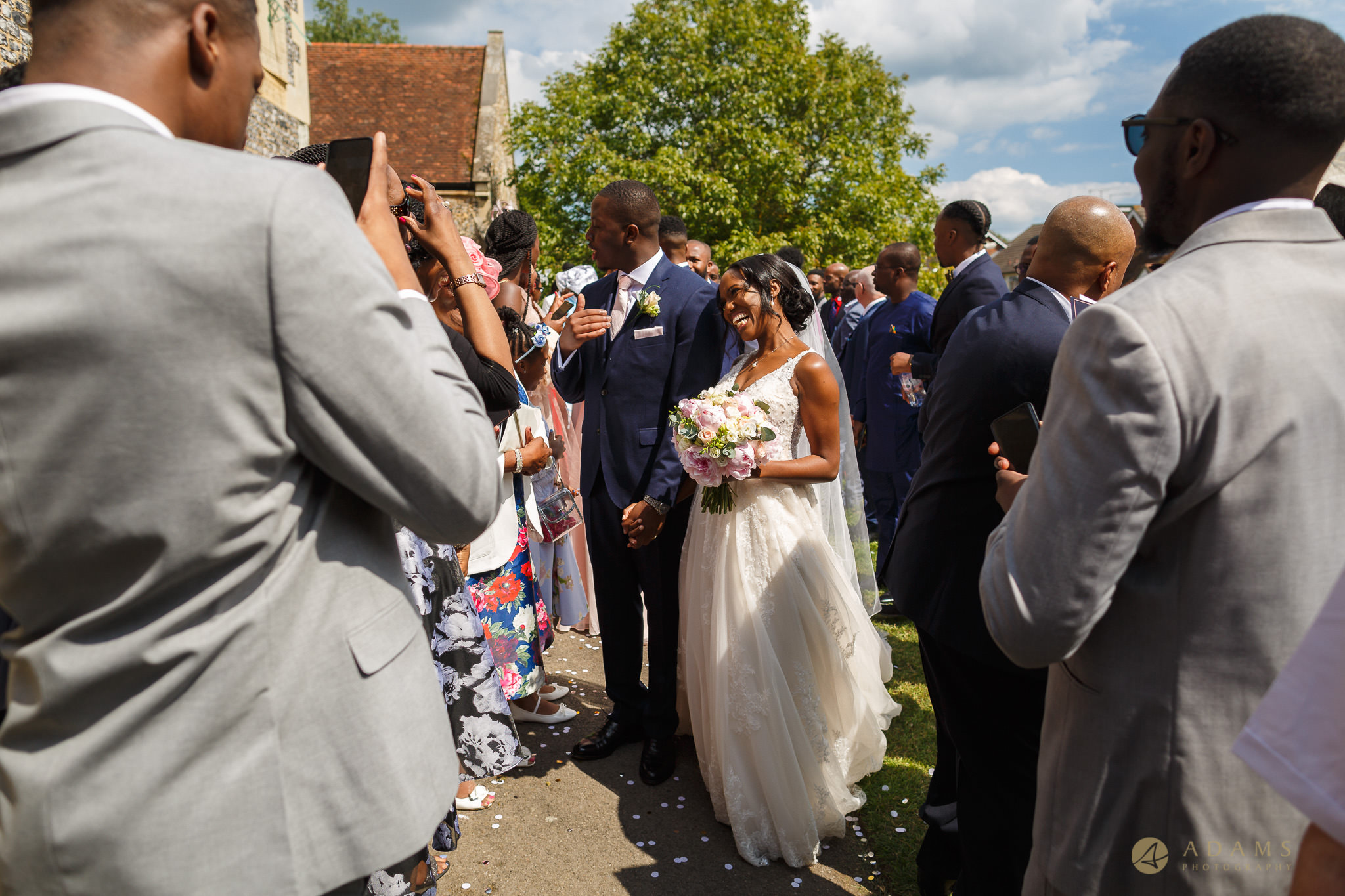 bride and groom talking to their guests