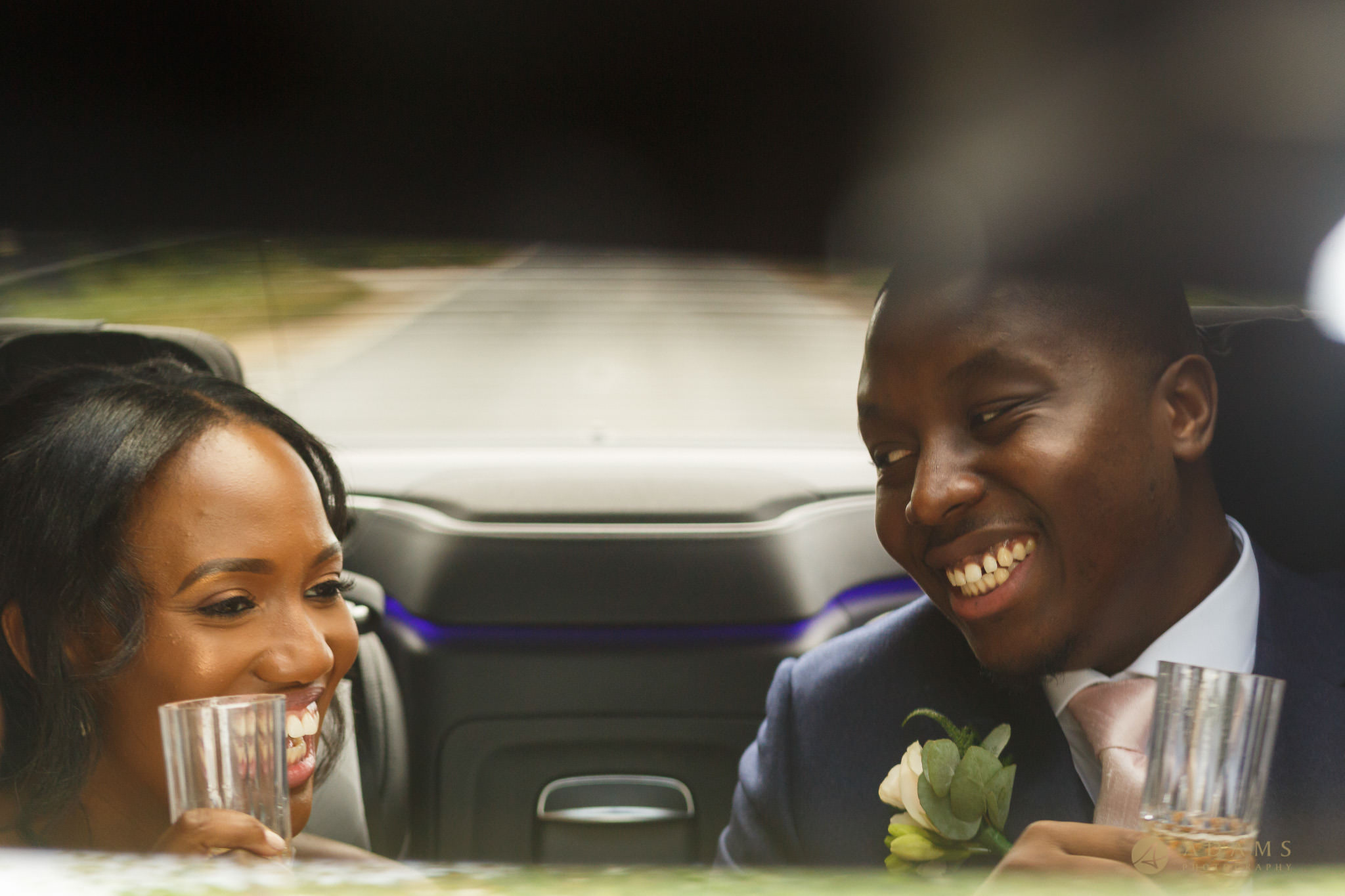 bride and groom i the car