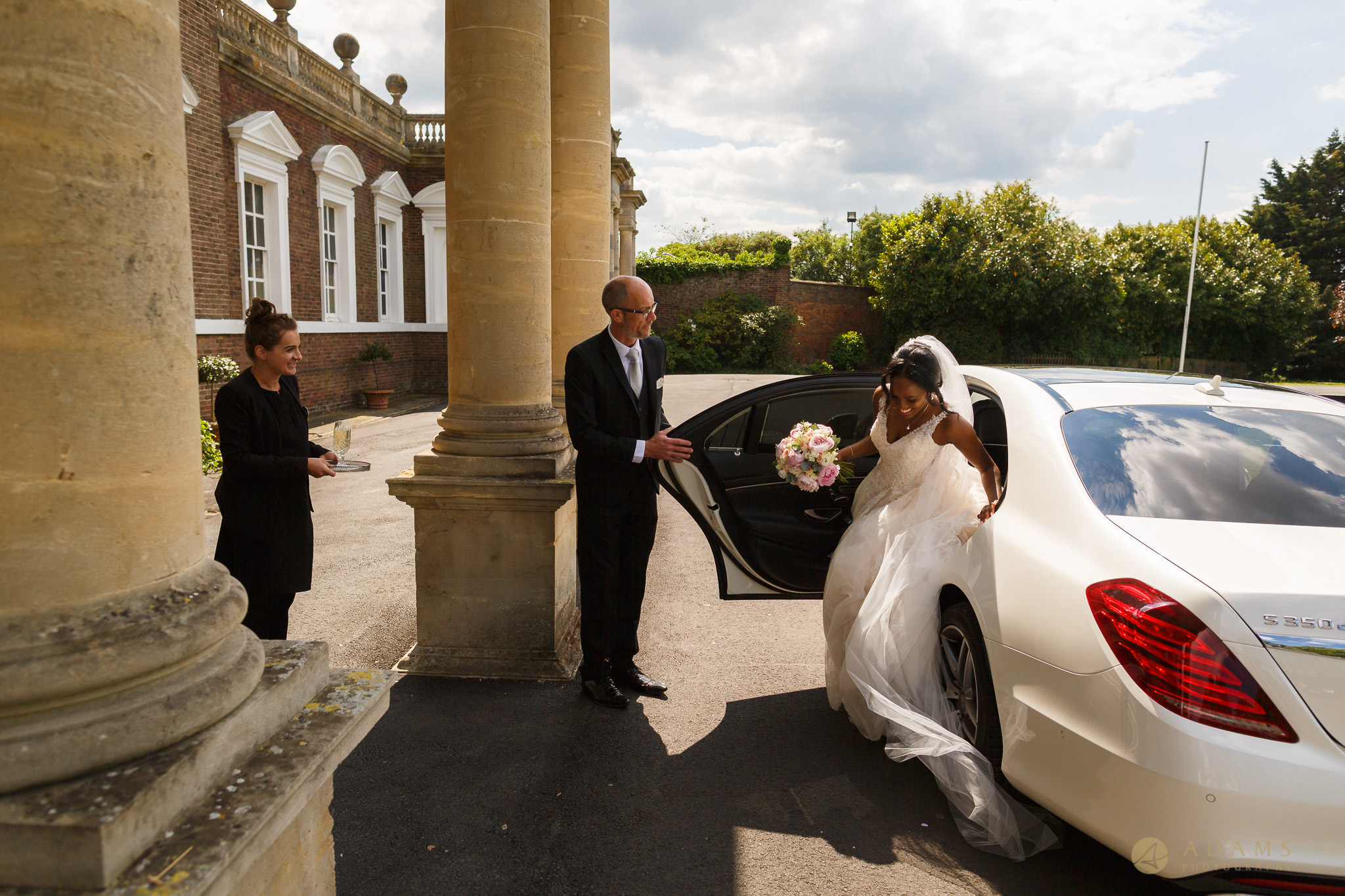 bride getting off the car in front of the Boreham House