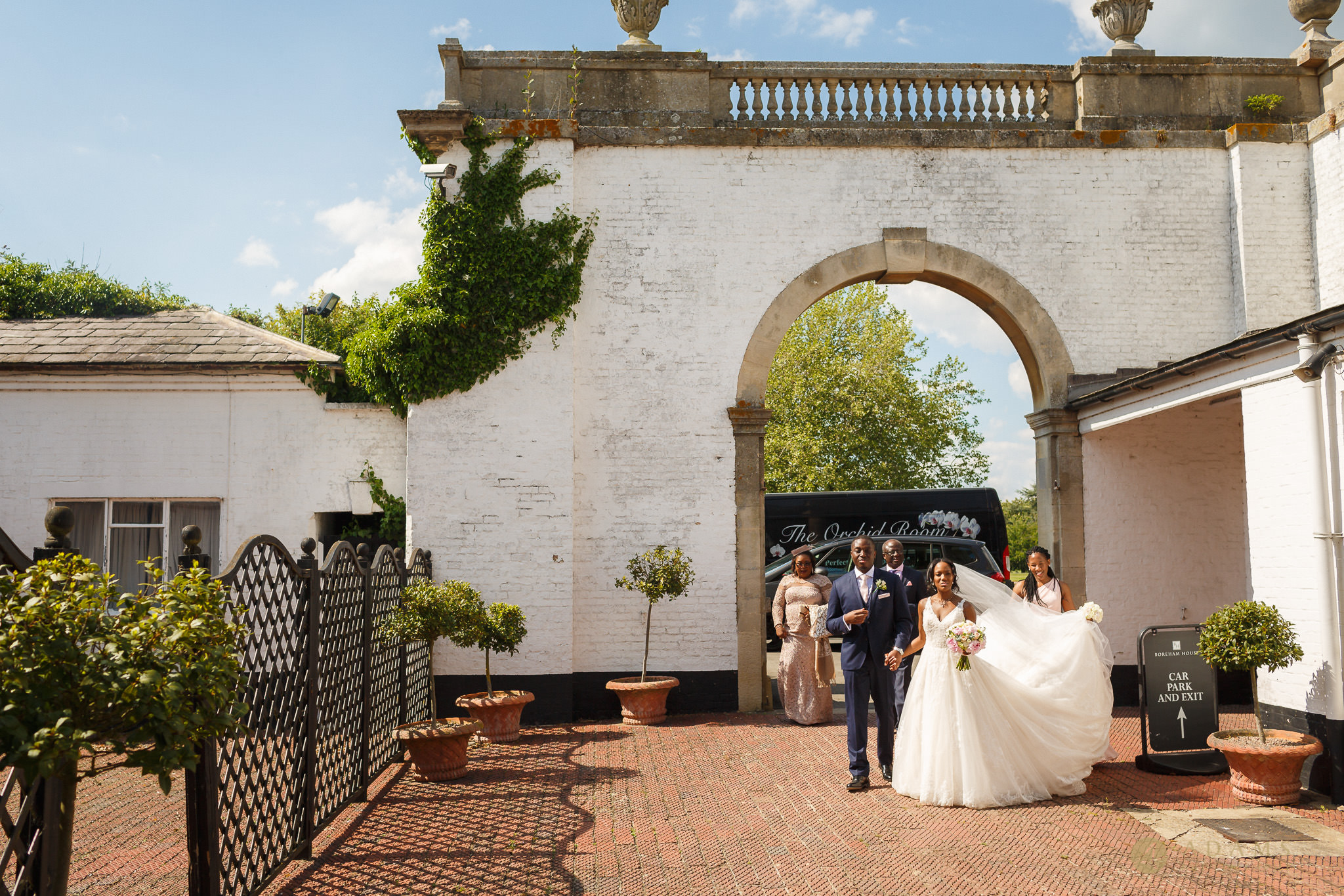 bride and groom walking to the marquee
