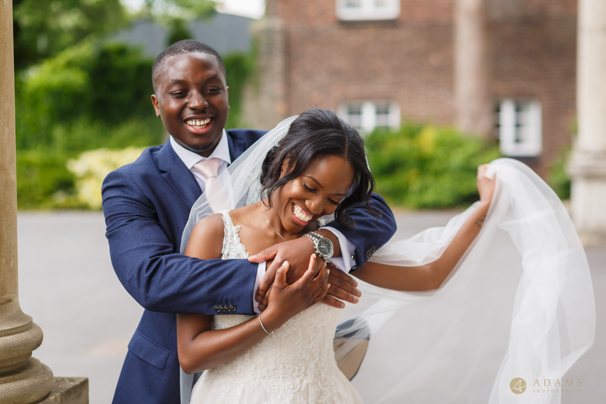 bride and groom having portraits session in front of the Boreham House
