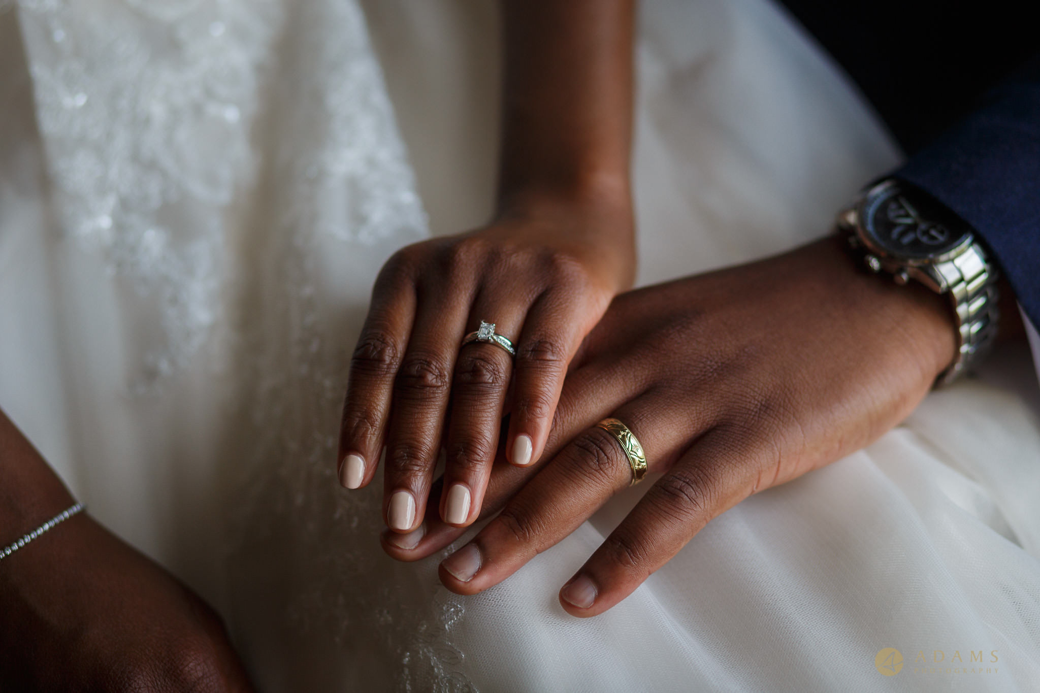 bride and groom show their rings