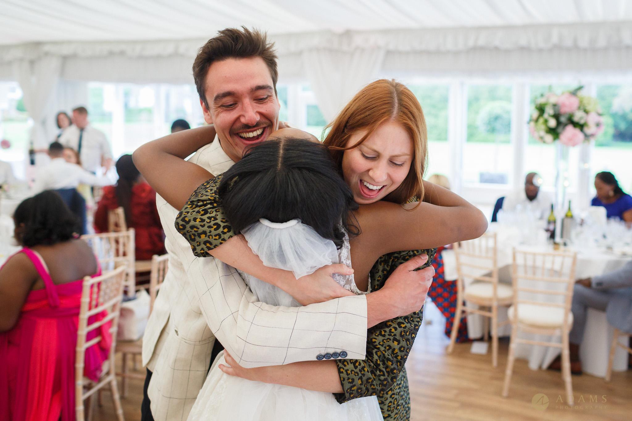 bride is hugging her guests