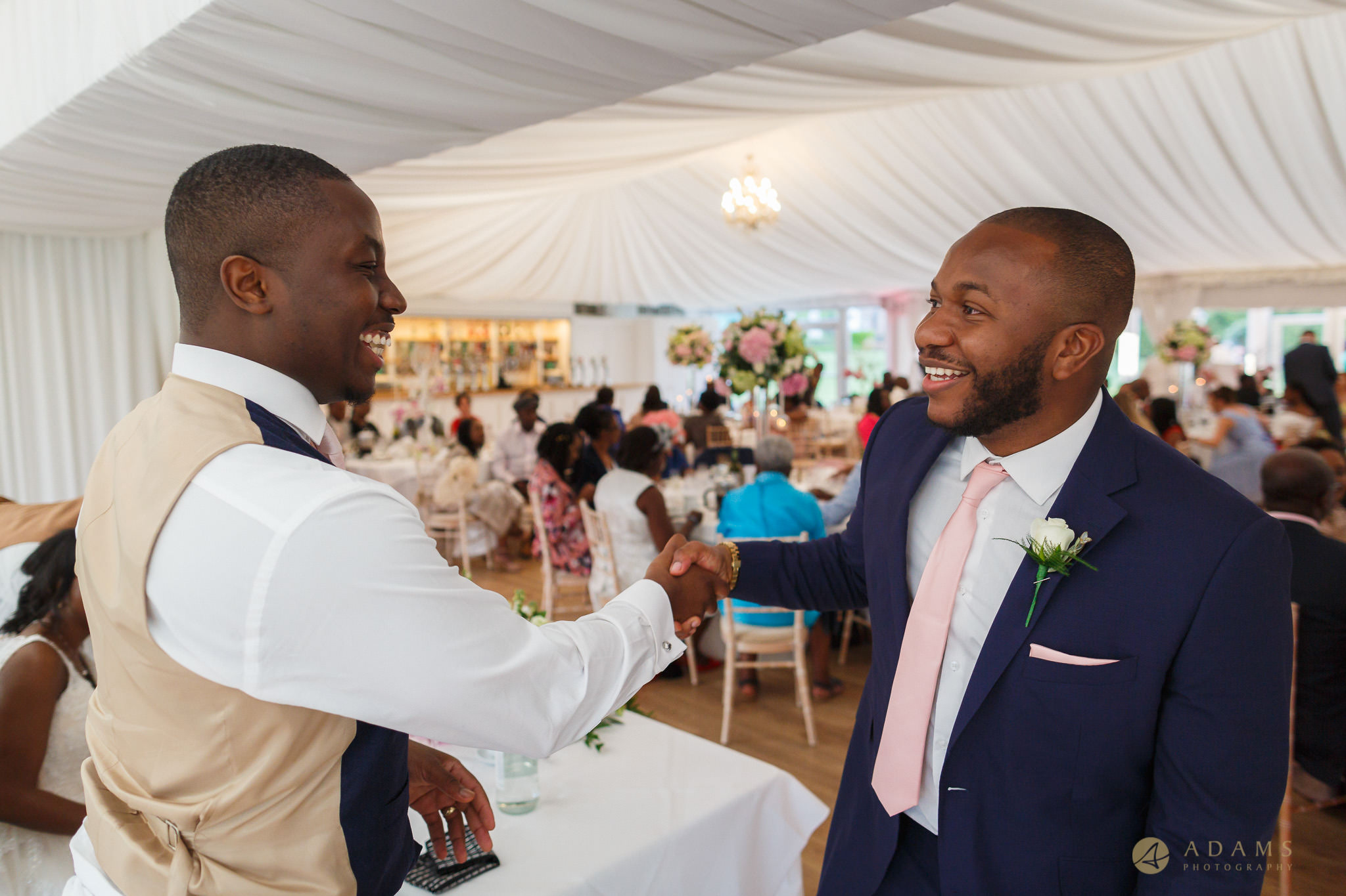 groom and his best-man shaking hands