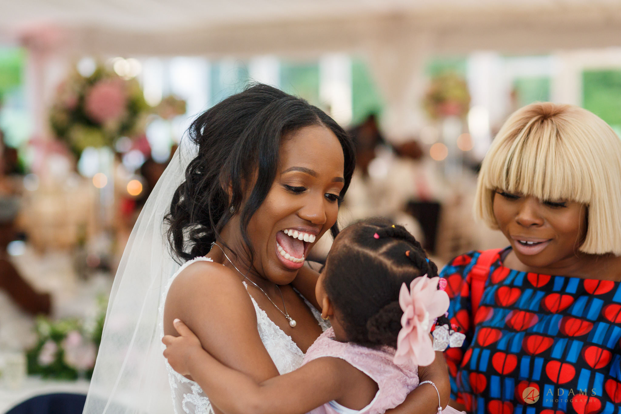 bride holing a baby