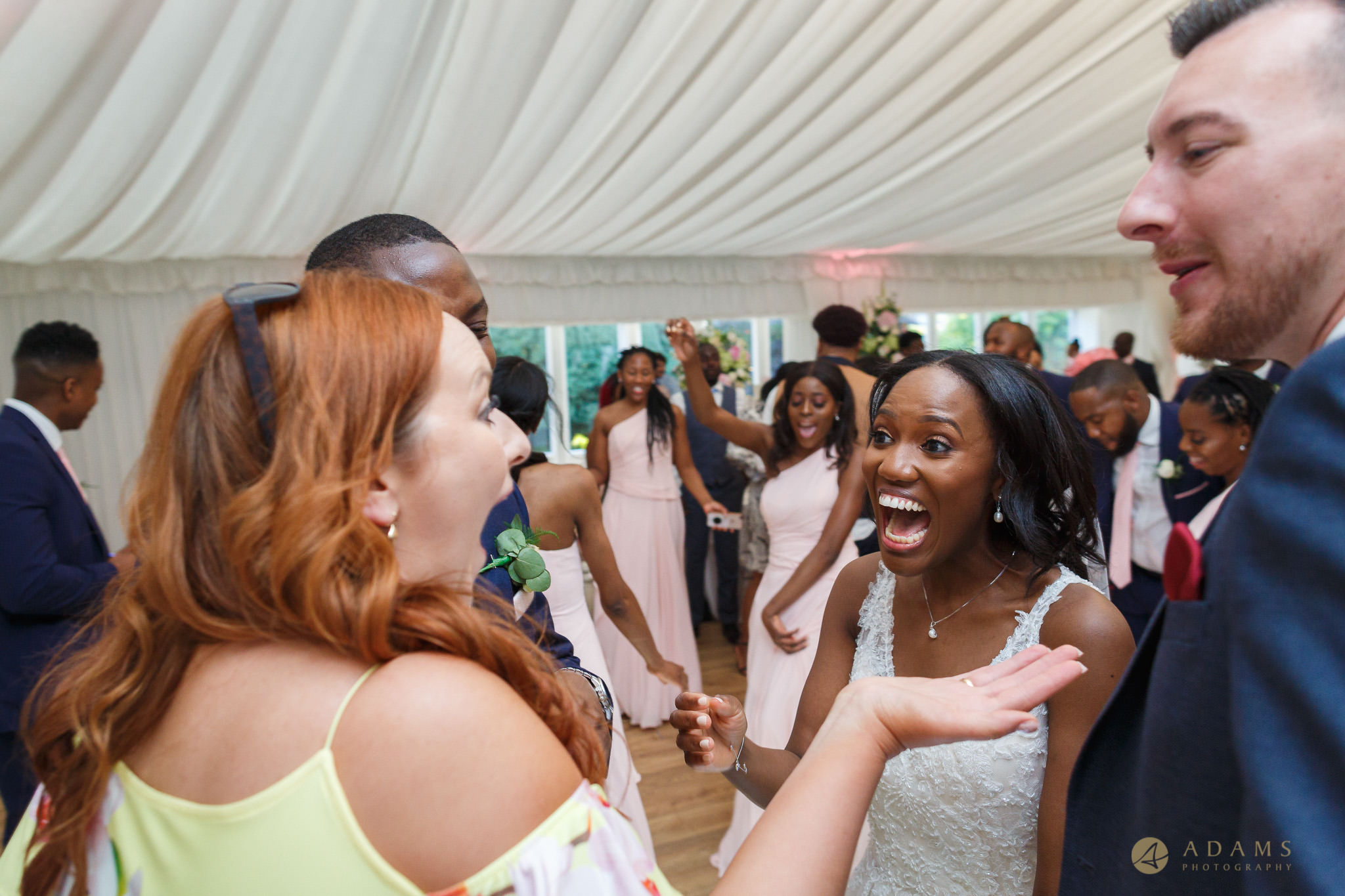 bride is having a good time with her guests