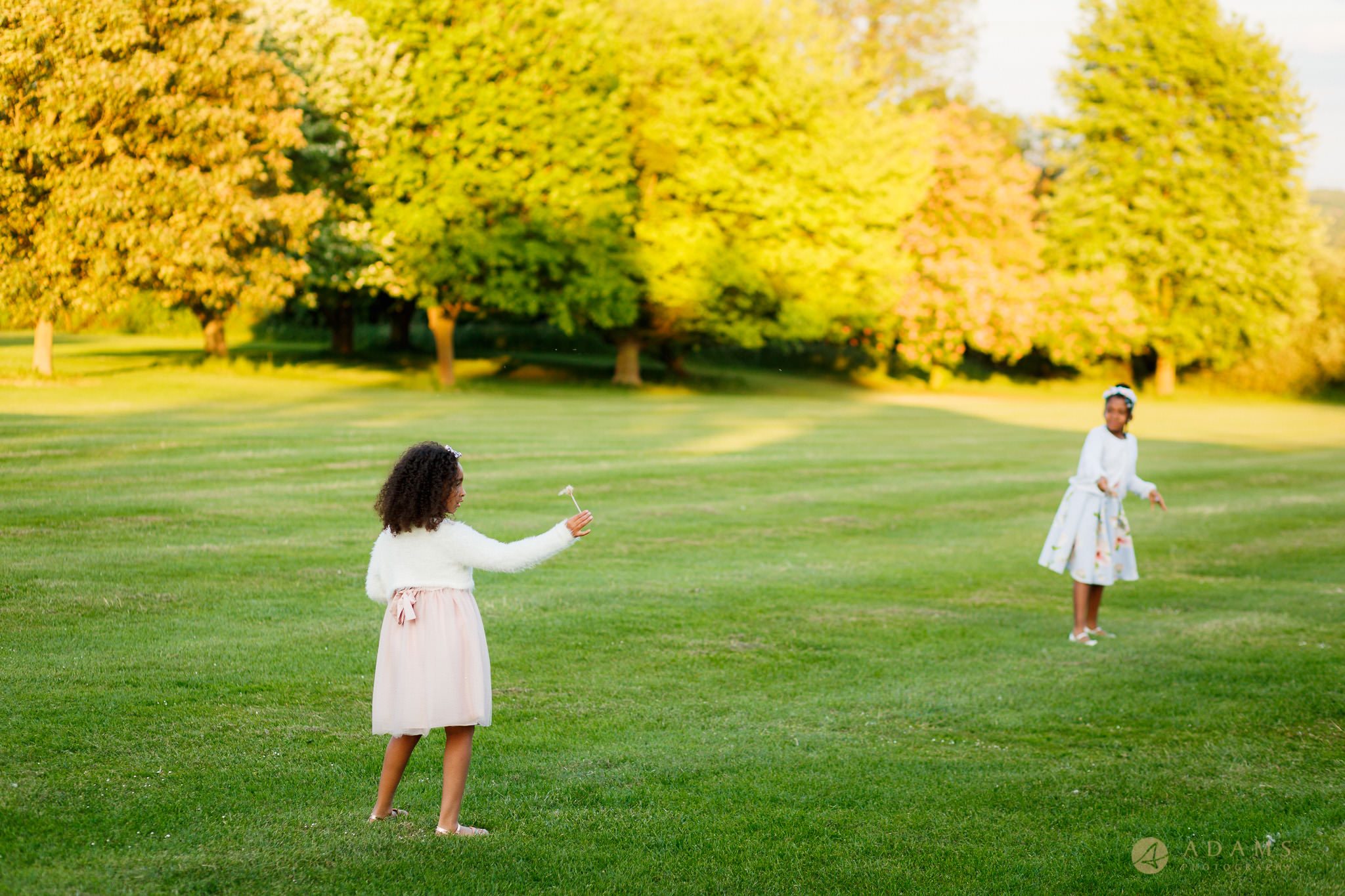 flower-girls playing on the grounds