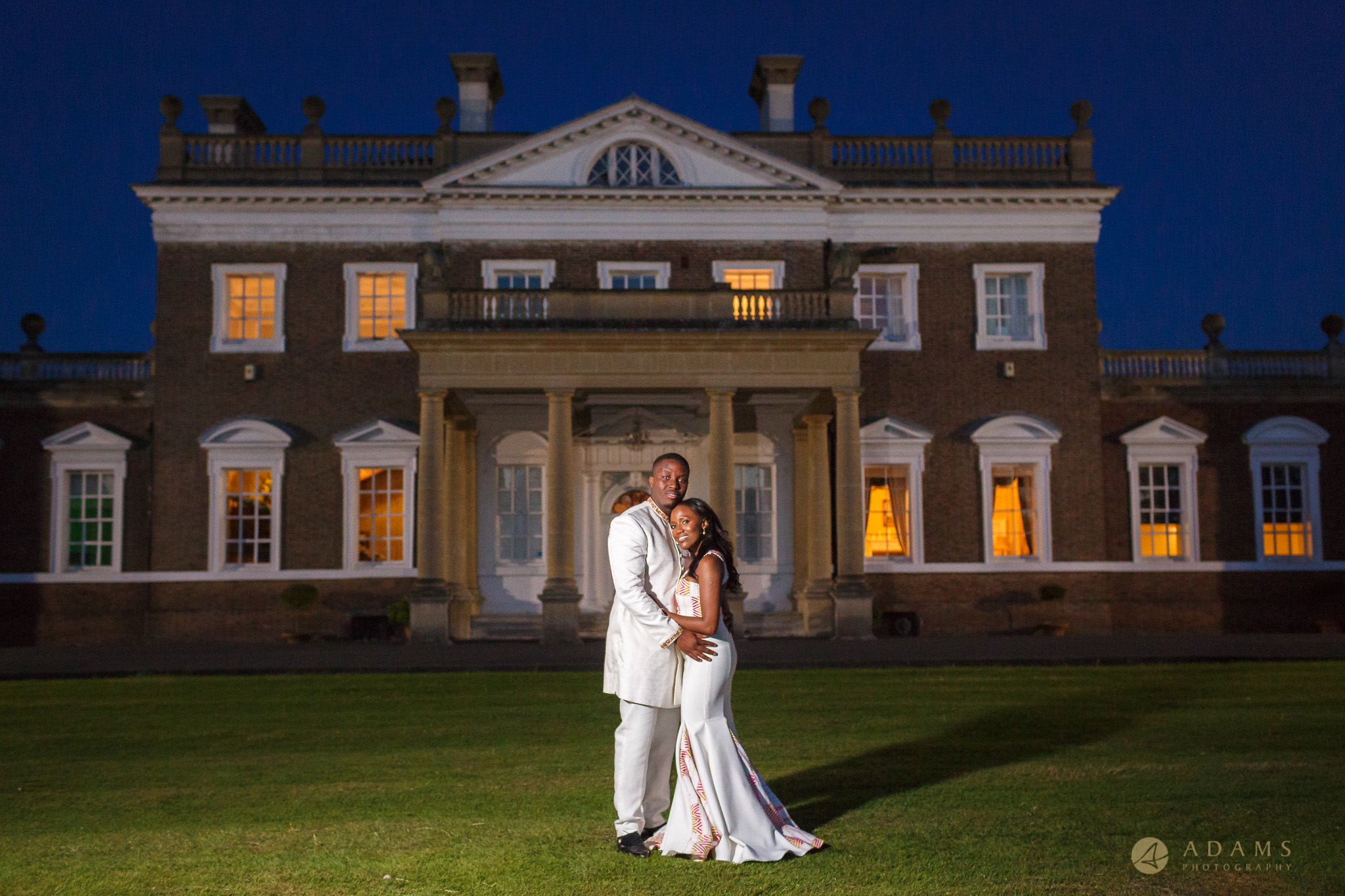 Boreham House wedding photography bride and groom in front of the venue
