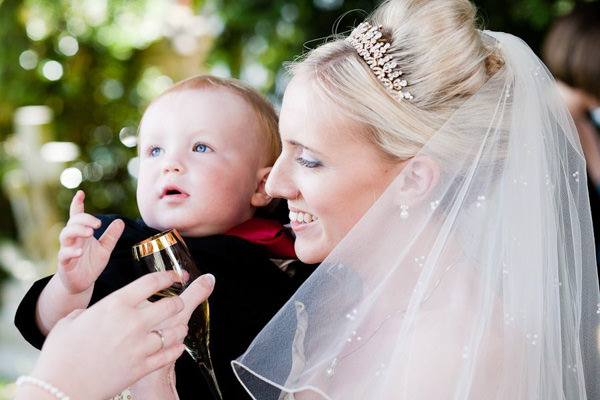 Buckinghamshire wedding photographer bride holding a baby