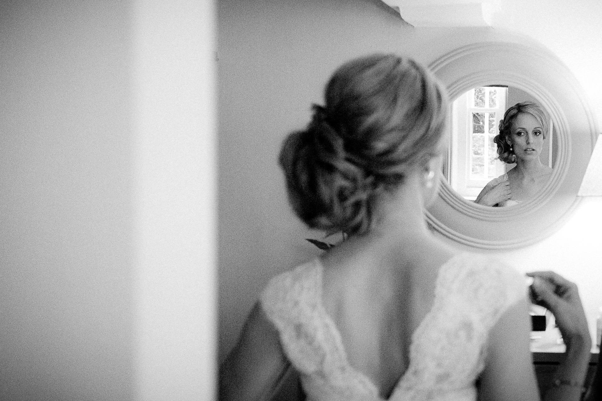 Buckinghamshire Wedding Videographer bride looking into the mirror