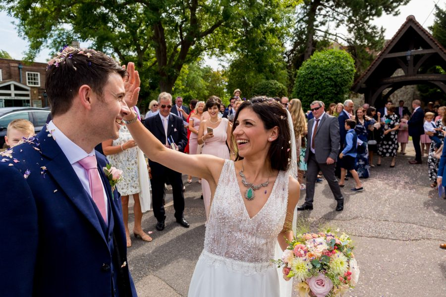 Kent Wedding Photography couple after confetti shot looking at each other