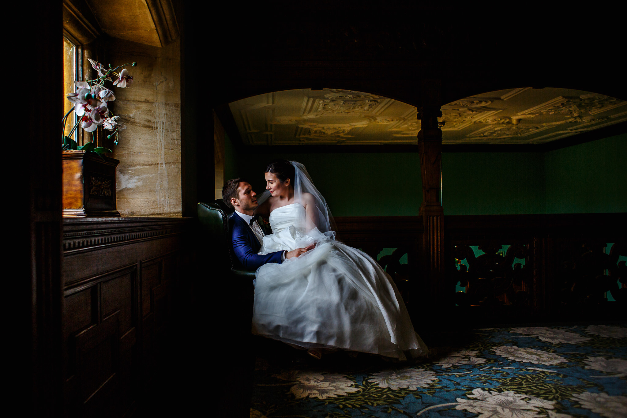 Bride and groom by the window at their venue in Oxfordshire