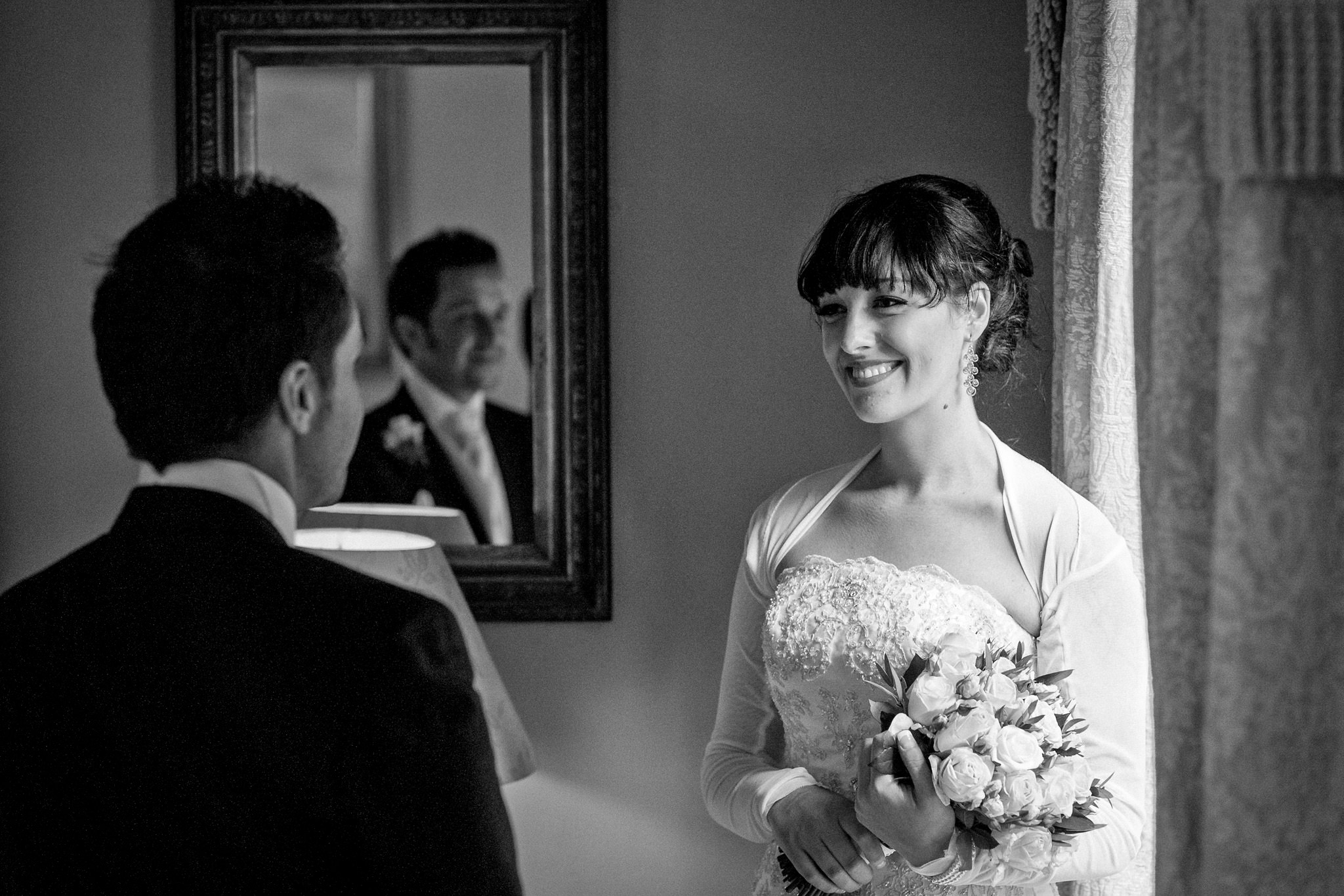 Sussex Wedding Videographer couple in the room looking at each other
