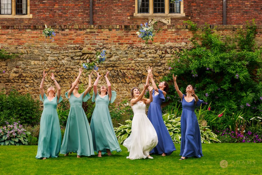 bride and bridal party tossing their bouquets