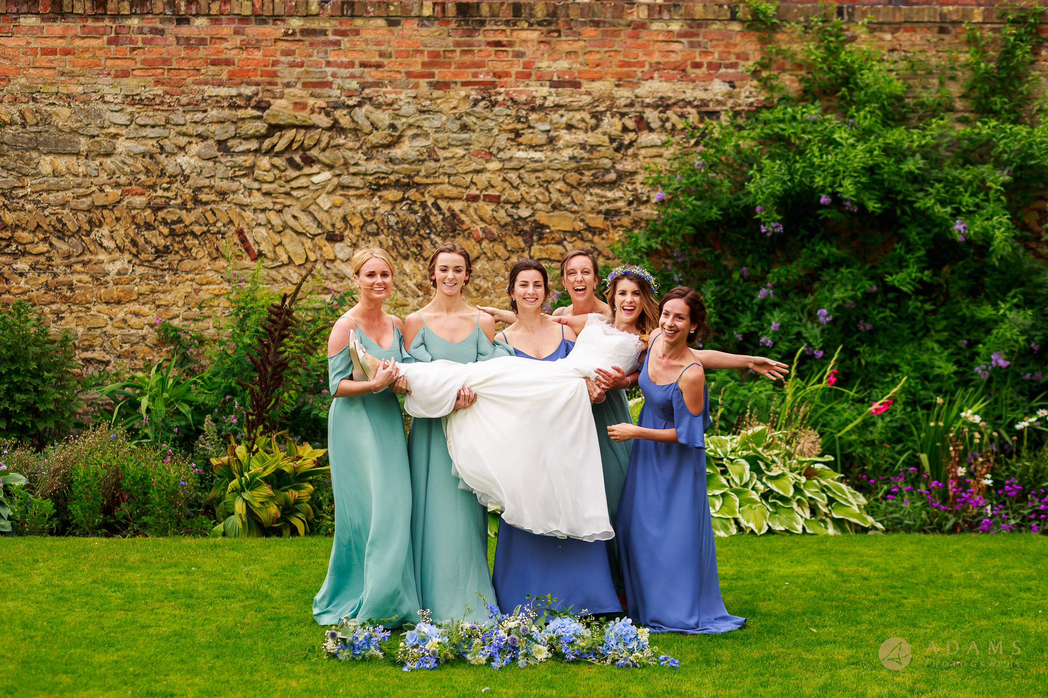 bridesmaids holding the bride on their hands