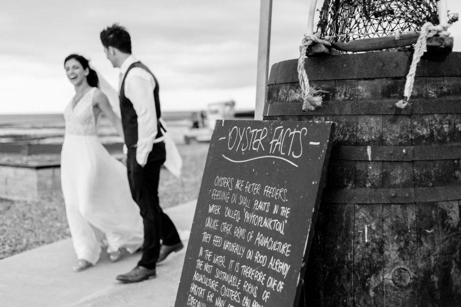 Wedding Photographer Kent couple walking by the seaside