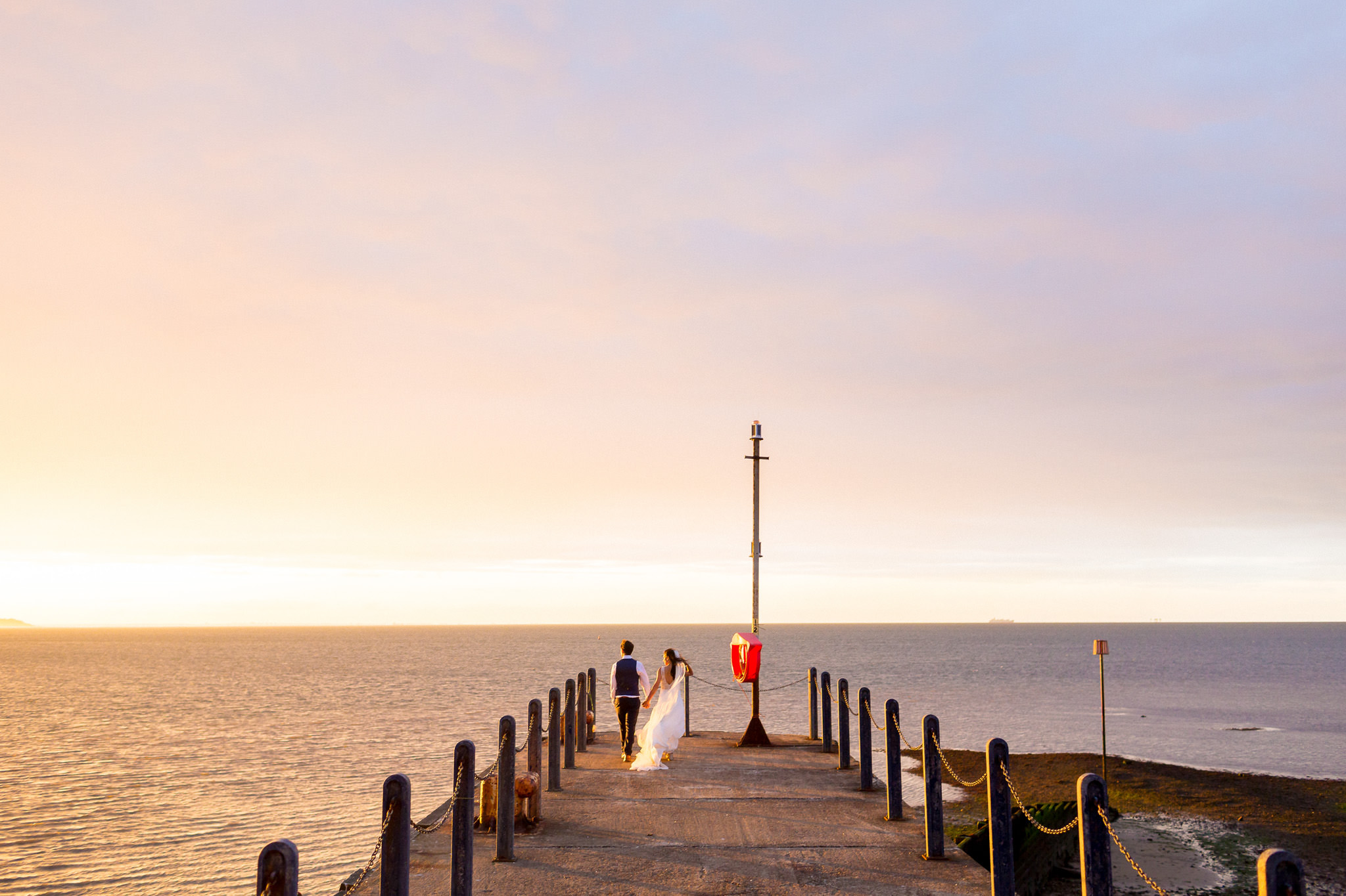 Wedding Videography Prices couple standing by the seaside
