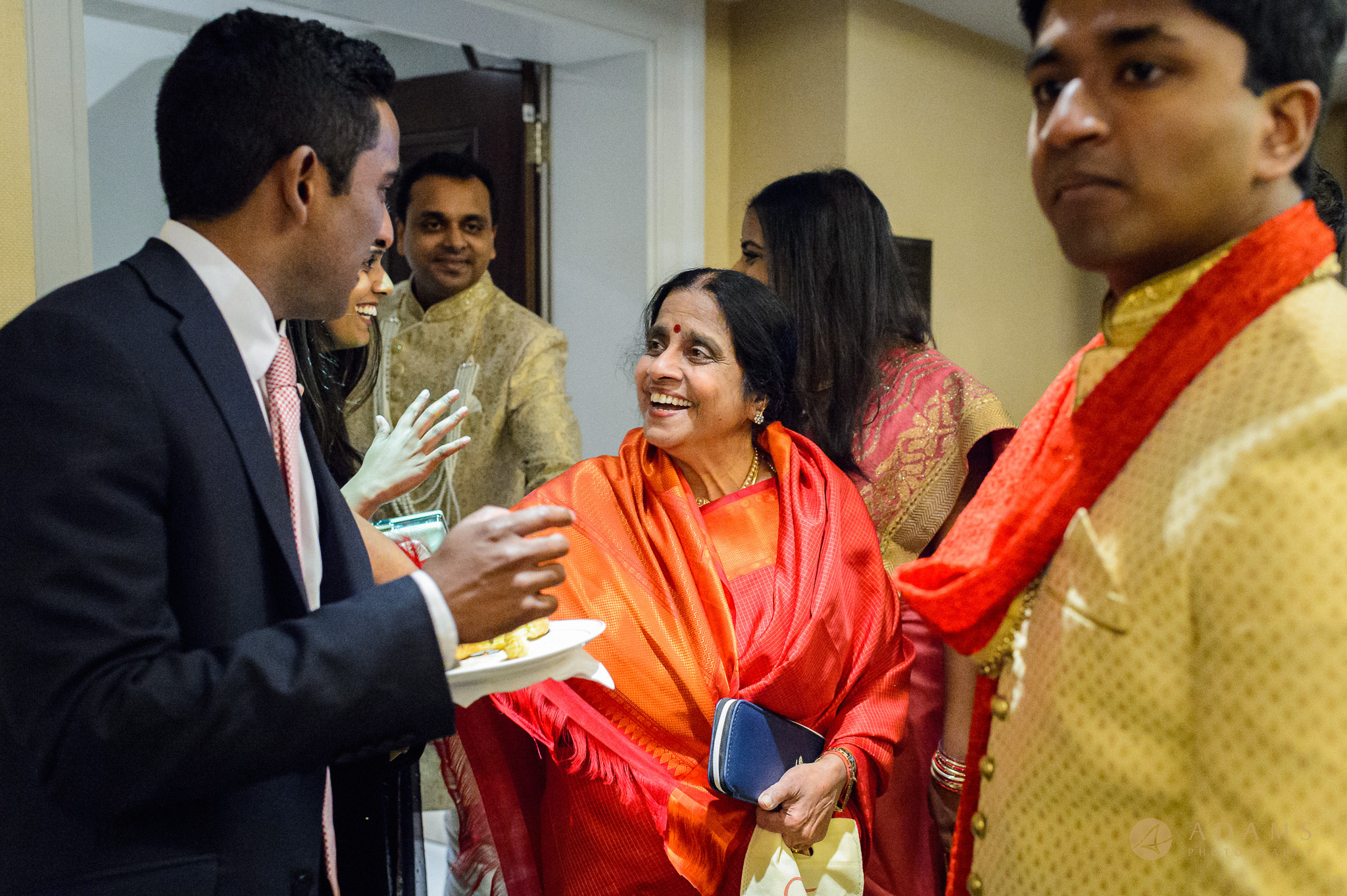 Mother of the groom greeting the guests
