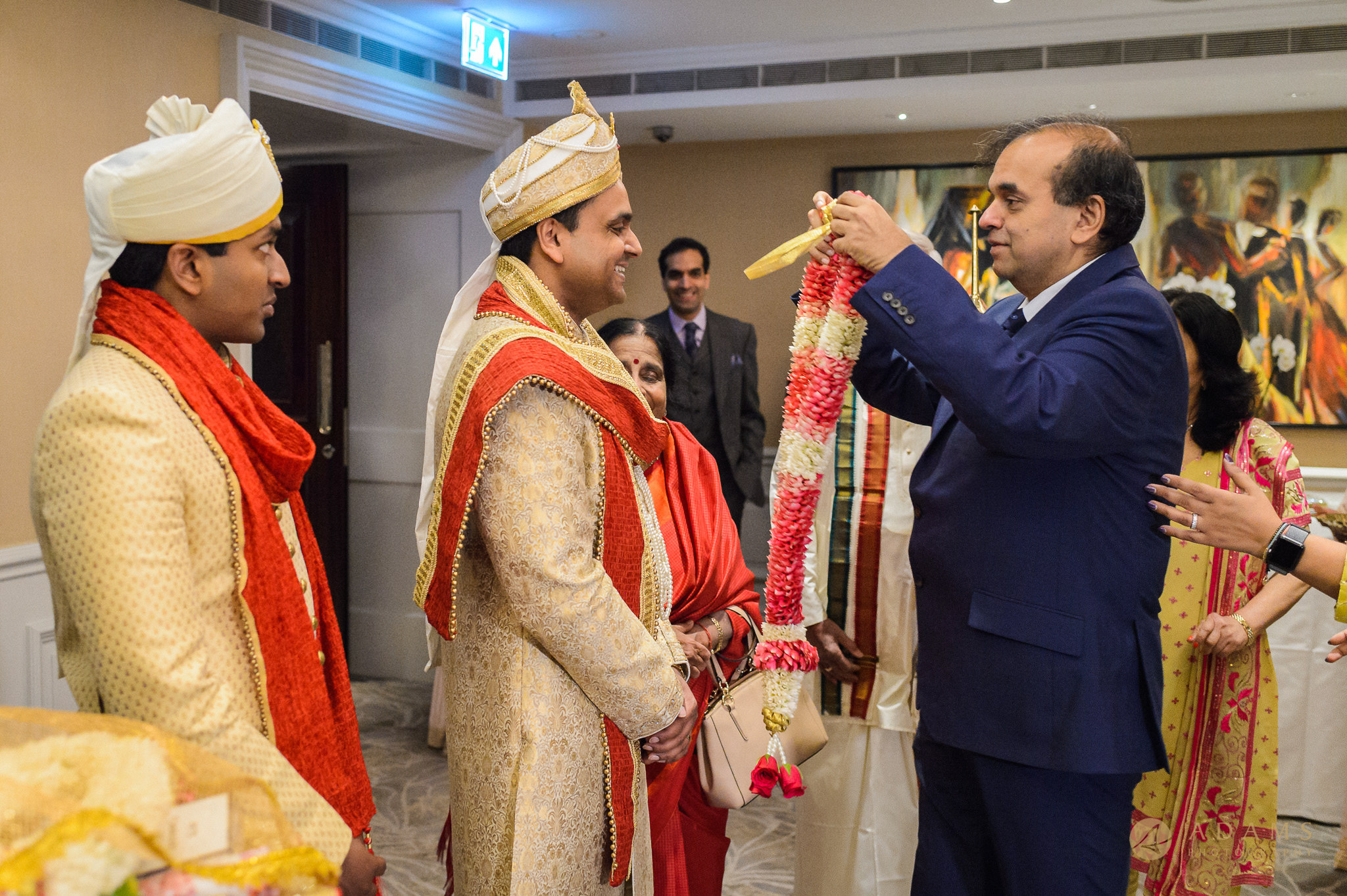 Garlands are being put on the groom