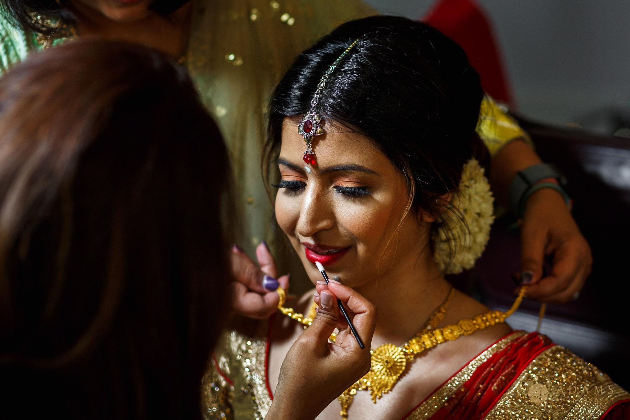Bride is getting changed Langham Hotel Wedding Photographer