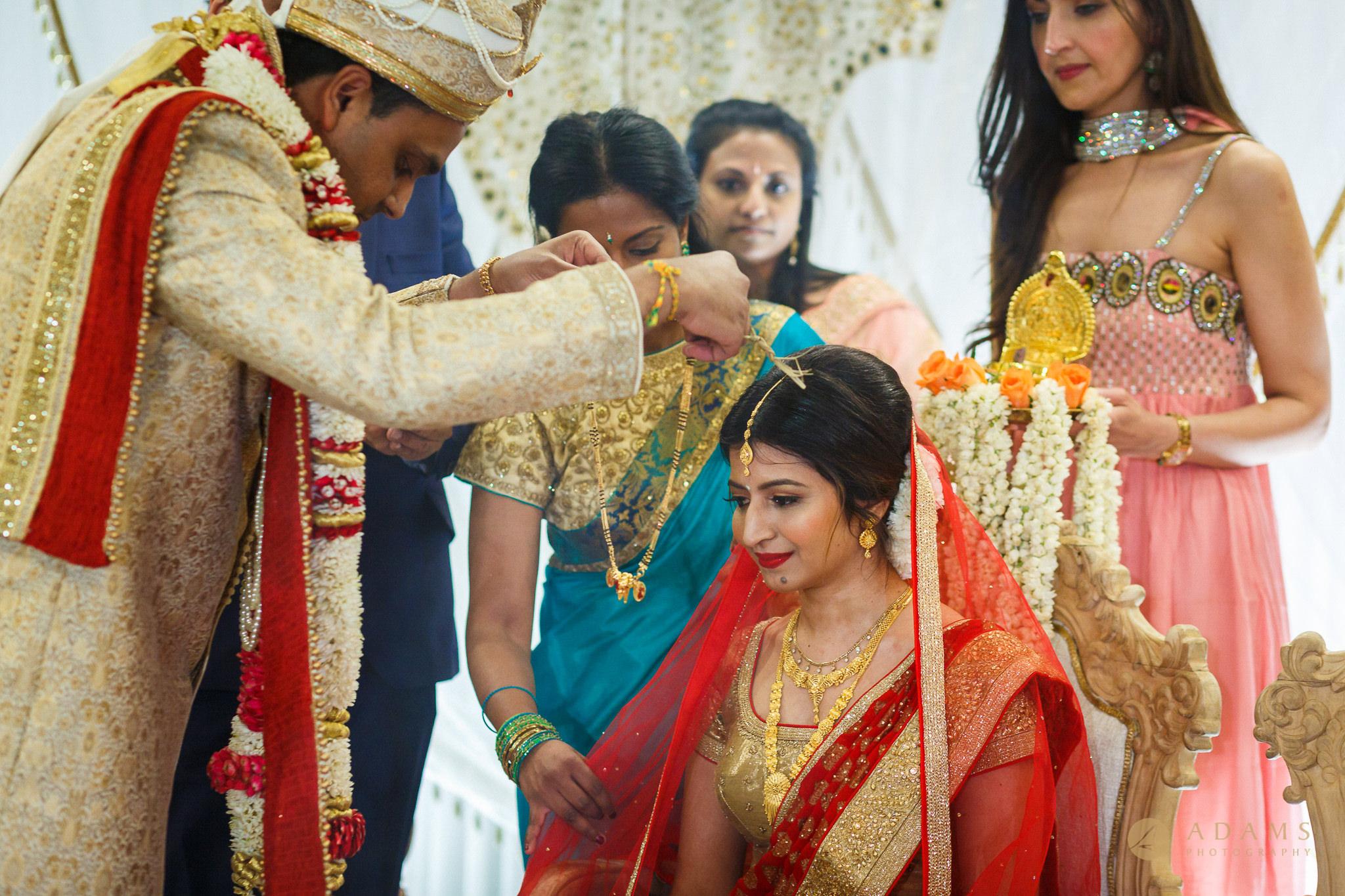 Groom put thali on the bride