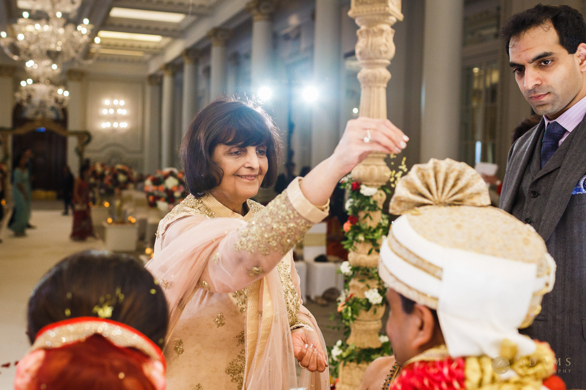 mother of the bride is blessing the couple