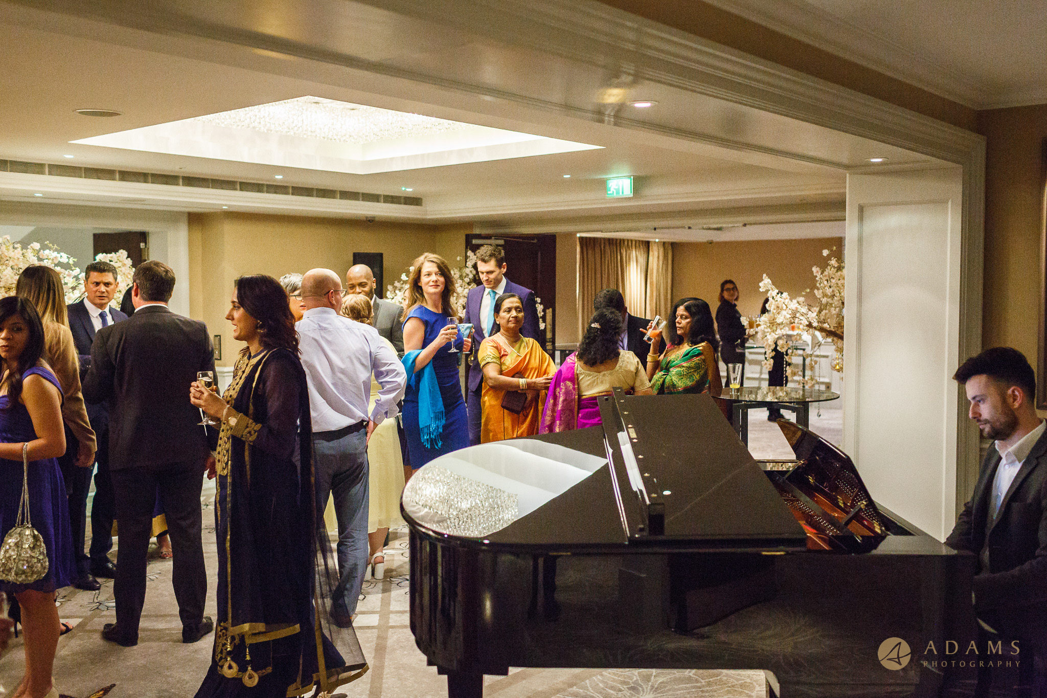 piona is playing at the wedding reception in Langham Hotel