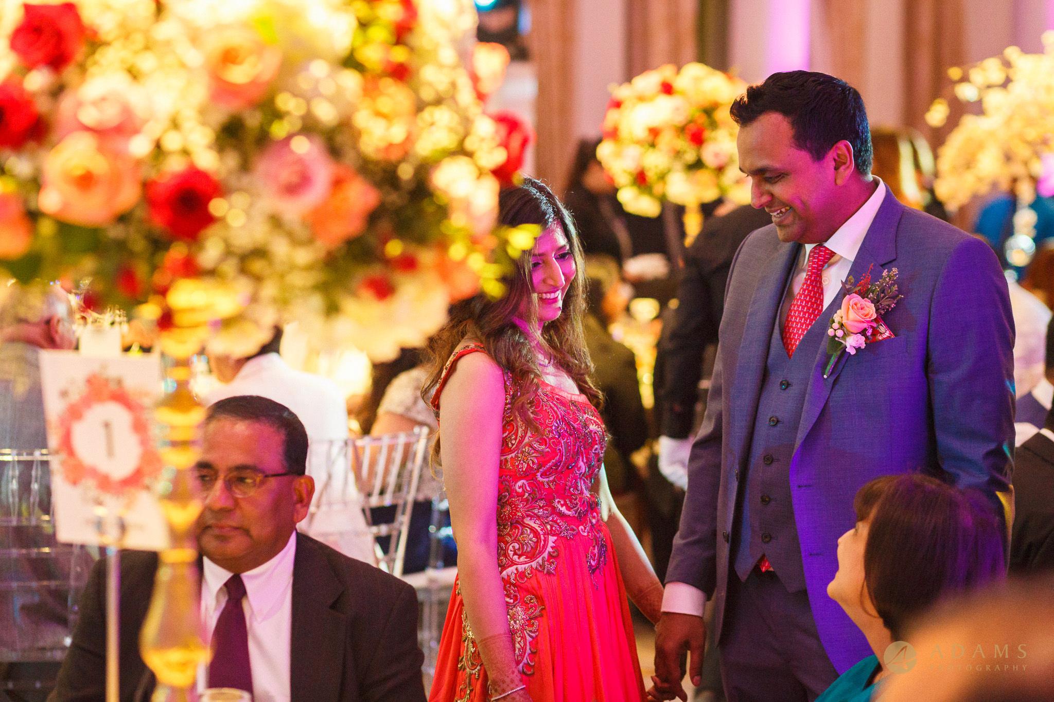 Bride and groom walking between the tables