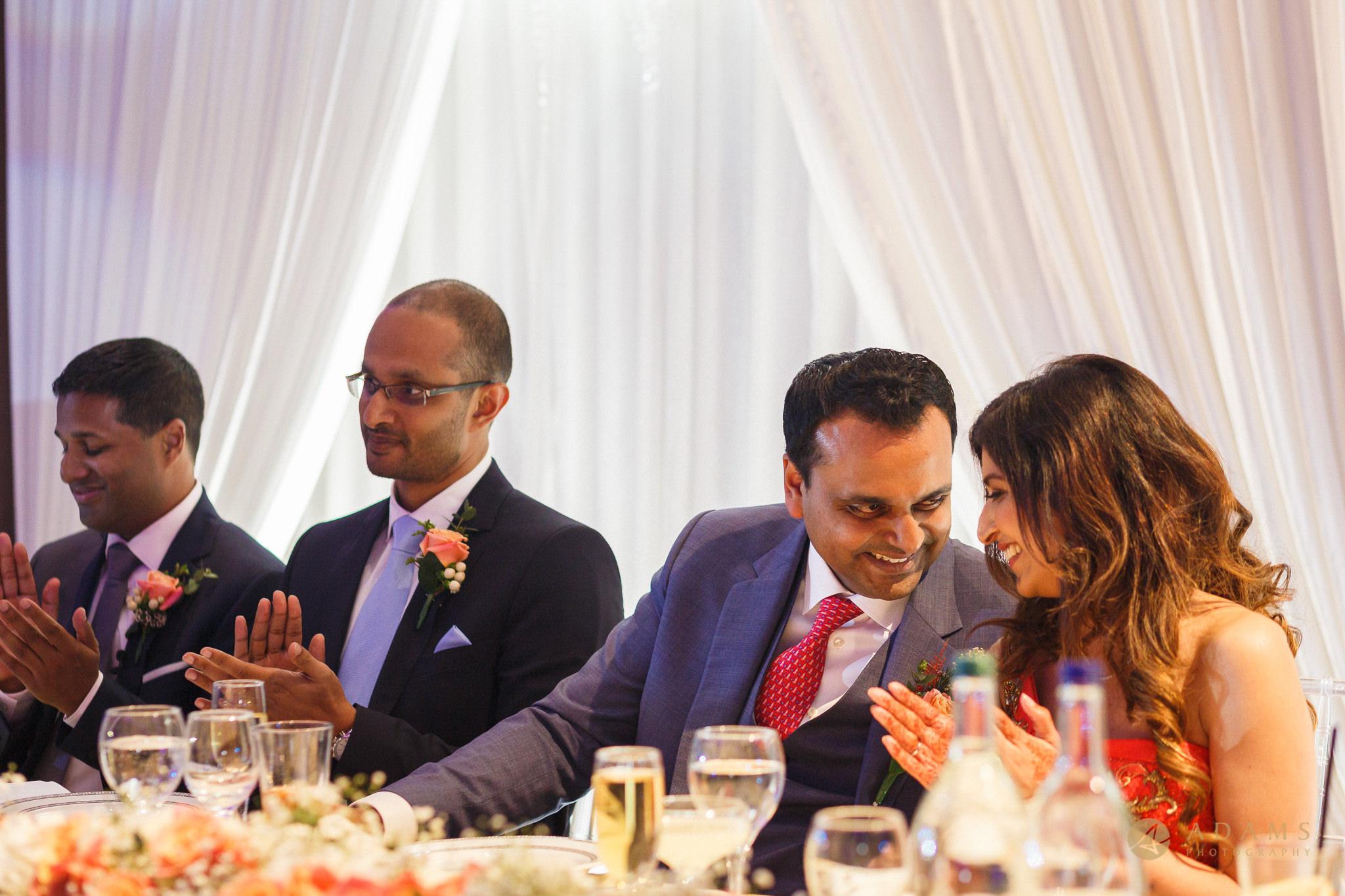 Groom looking deep in the eyes of the bride at their wedding in Langham Hotel in London