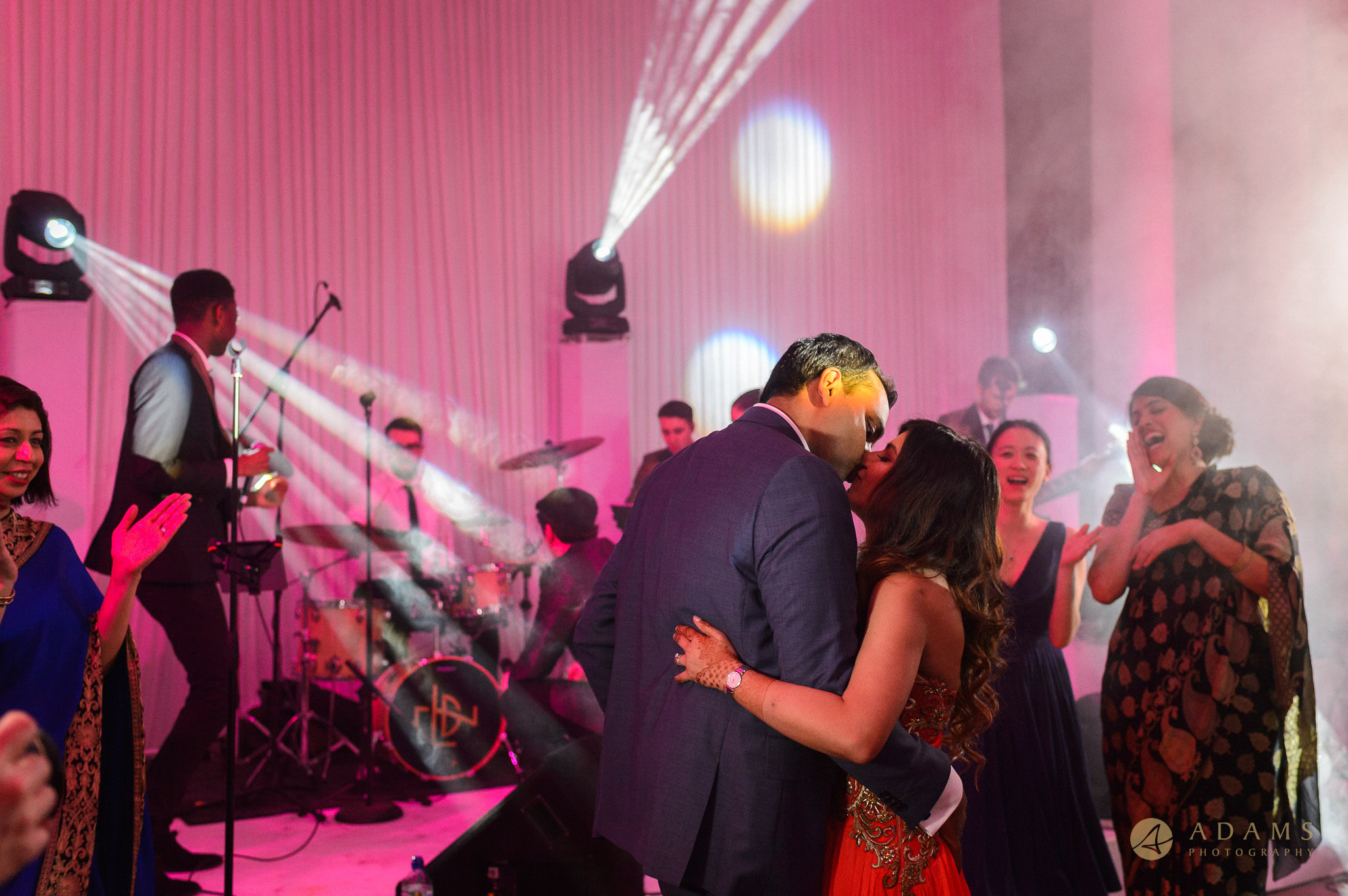 newly weds kissing on the party floor