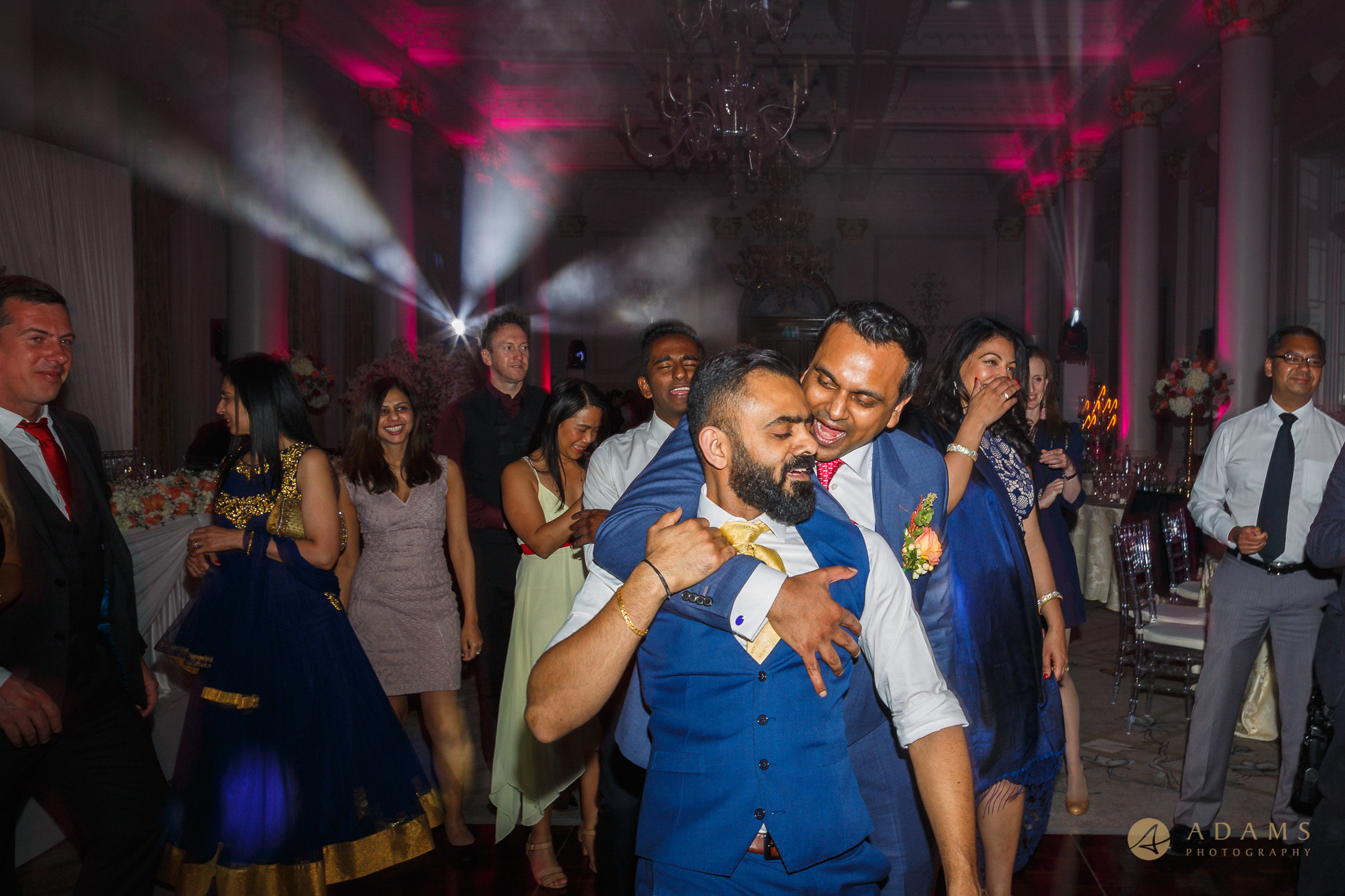 groom and his best man dancing