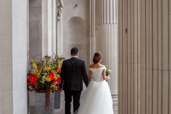 Old-Marylebone Town Hall Wedding Photographer taking pictures by the columns at the Old Marylebone Town Hall
