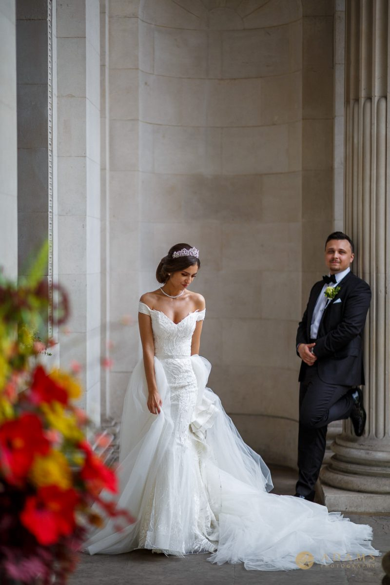 Old-Marylebone Town Hall Wedding Photographer couple posing outside the registry office