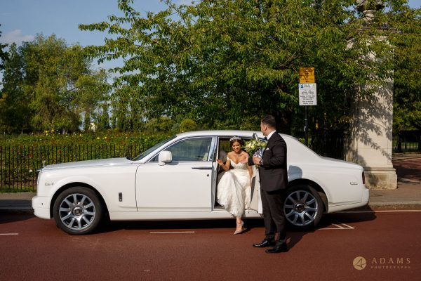 Old-Marylebone Town Hall Wedding Photographer couple getting off the car