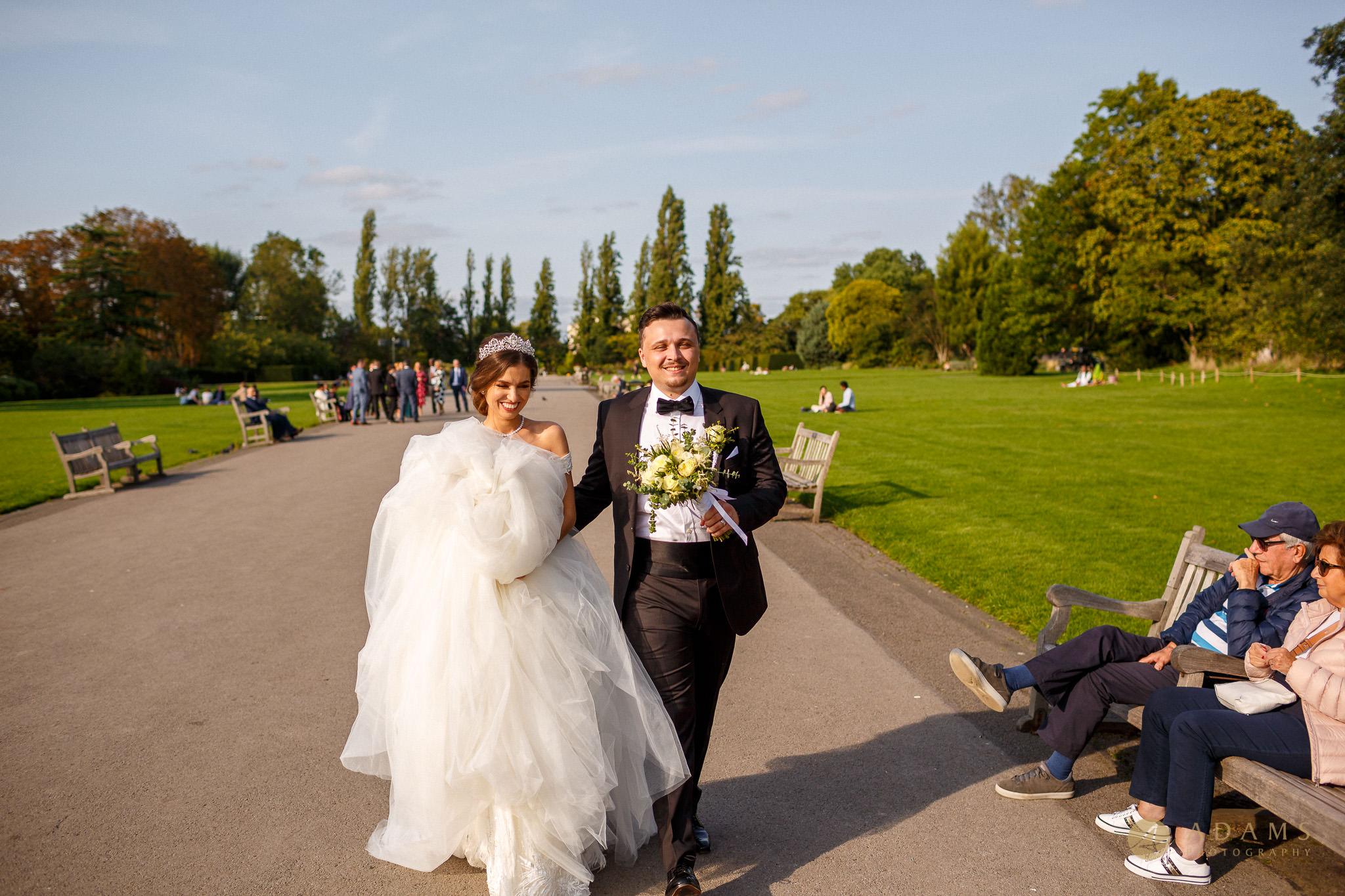 Bride and groom walking smiling