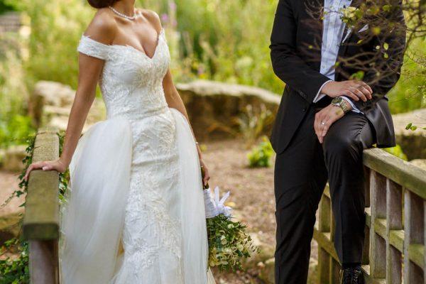 Bride and groom posing on the bridge