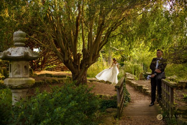 Bride showing her beautiful dress to the groom