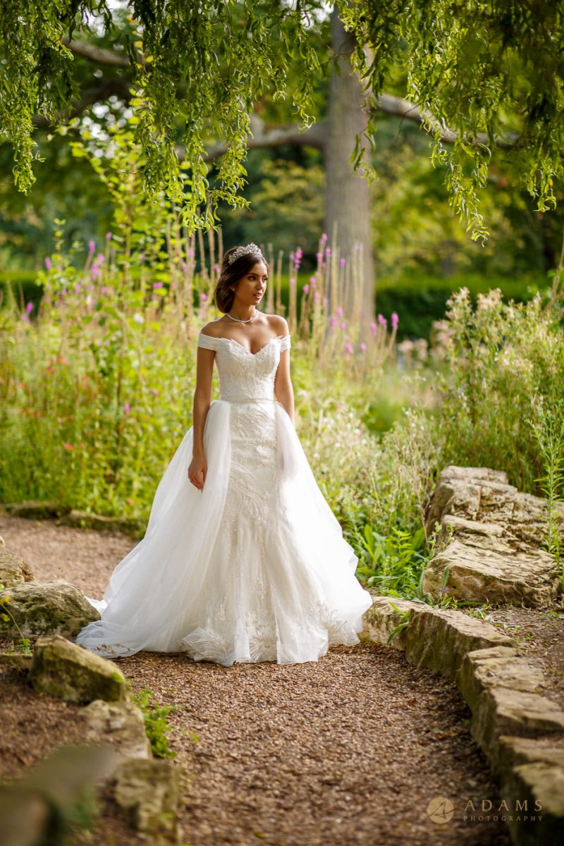Bride on her own showing the beauty of her dress