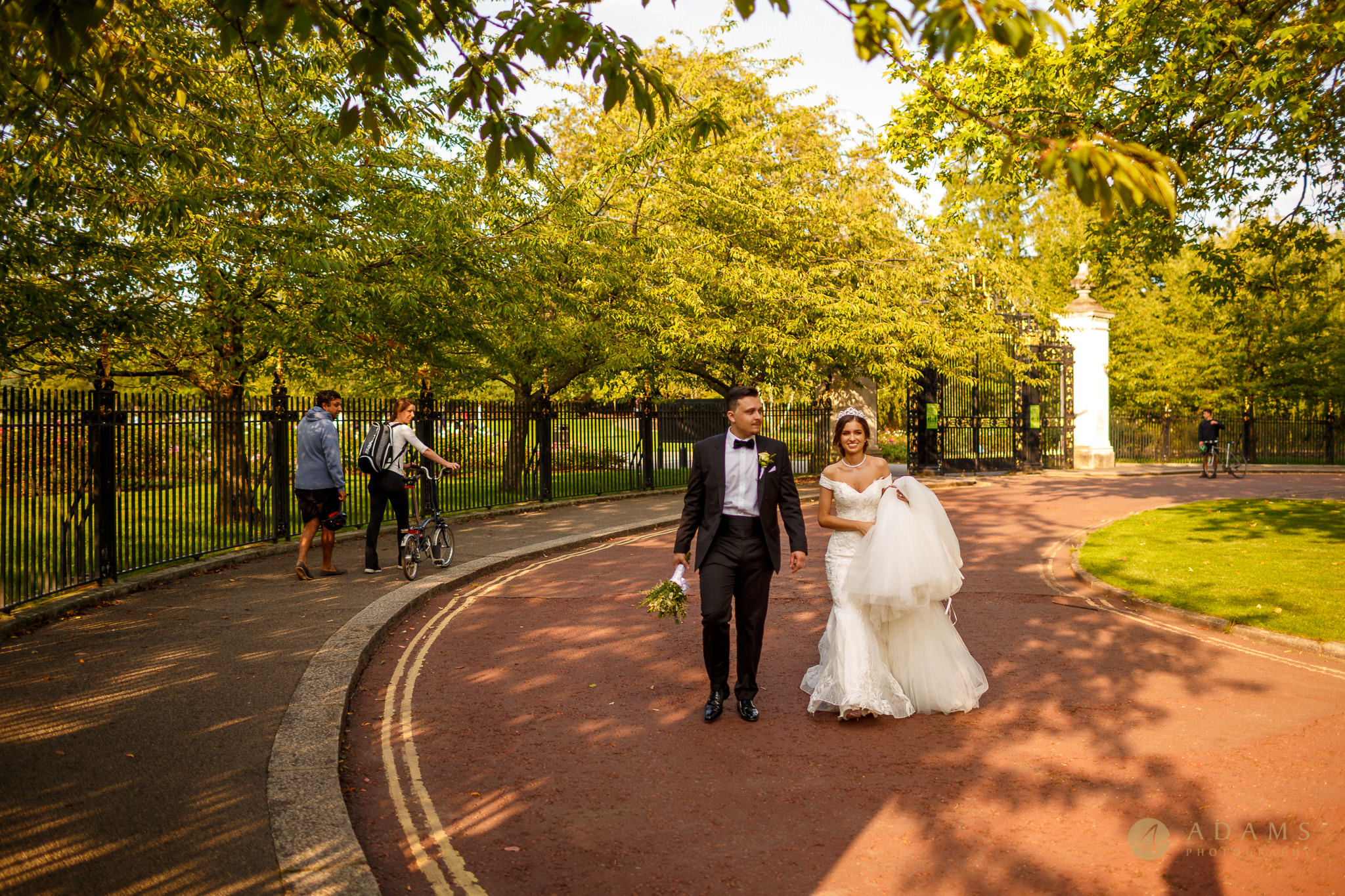 bride and groom exit the park