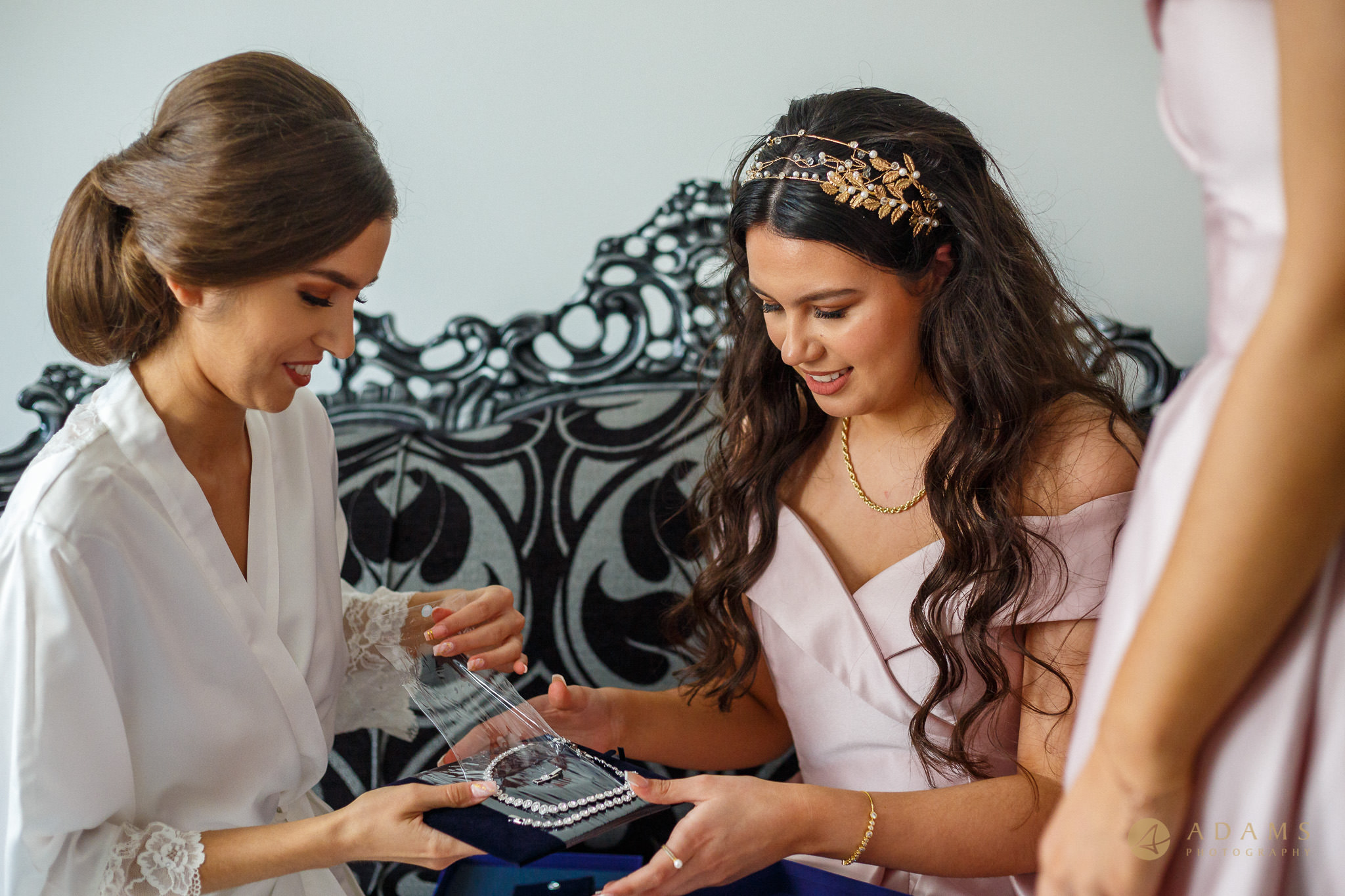 Old-Marylebone Town Hall Wedding Photography bride and bridesmaids selecting the jewellery