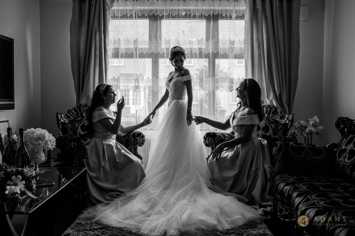 Old-Marylebone Town Hall Wedding Photography bride and bridesmaids posing by the window.