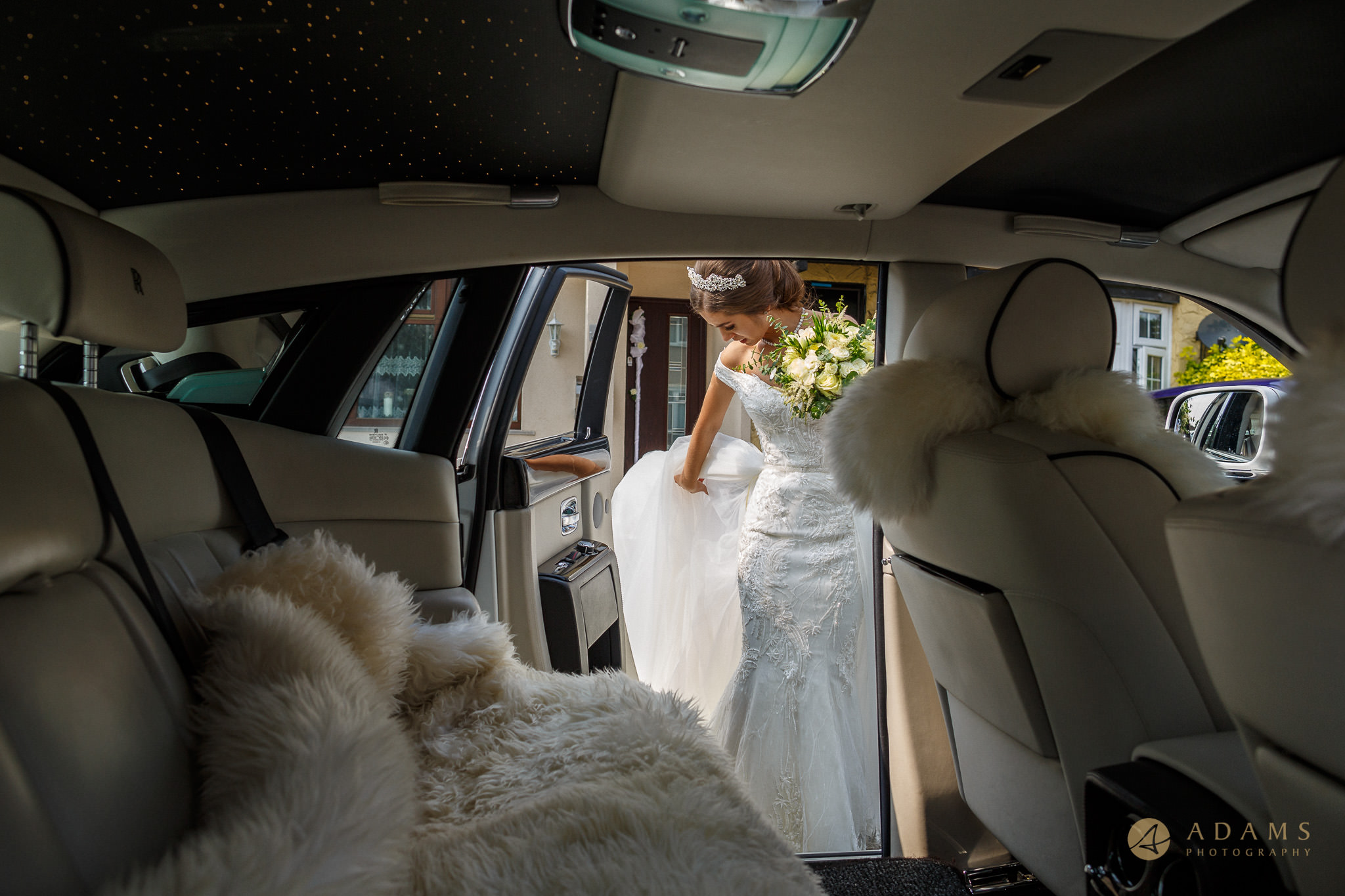 Bride getting into the car