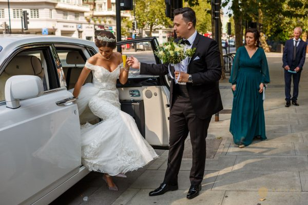 Bride and groom getting of the car