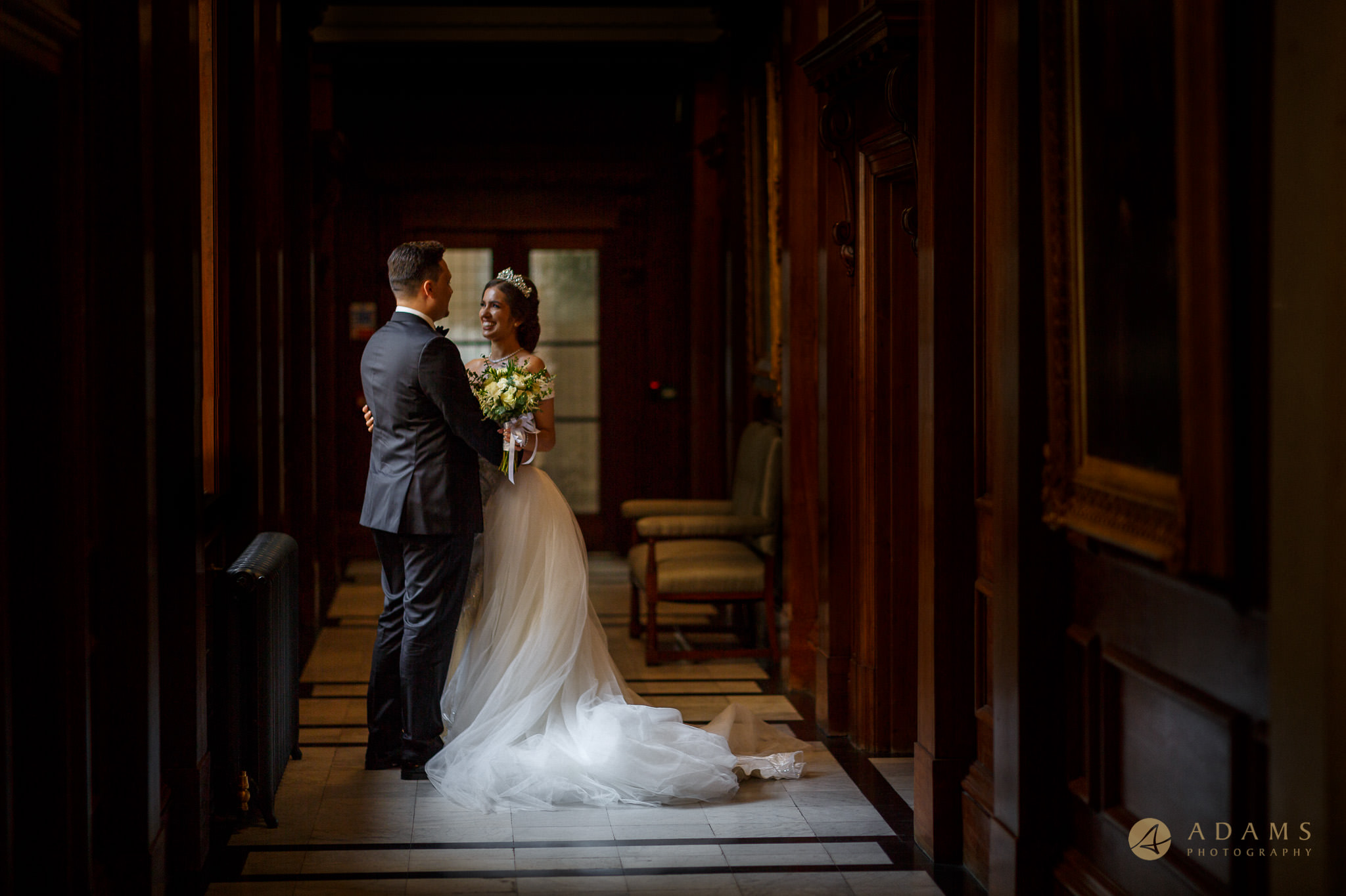 bride and groom in the hall by the window