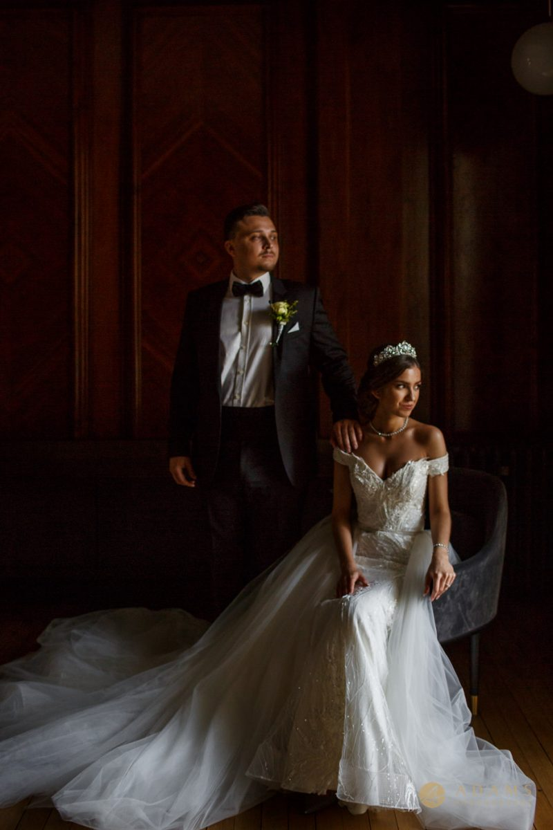 Bride and Grooms posing in the Paddington Room