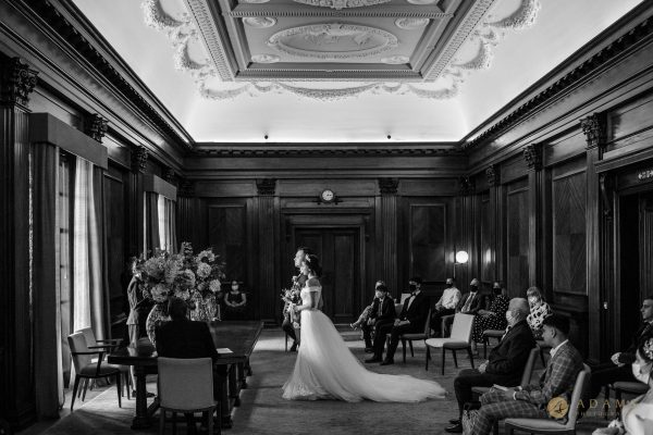 Black and white photo of the couple getting married in Westminster Room at Old Marylebone Town Hall