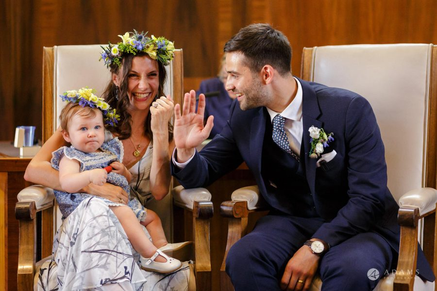high five with the bride and groom at their London wedding