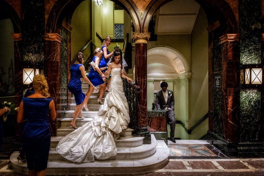 London Wedding Photographer Portfolio bride and the bridesmaids posing on the stars