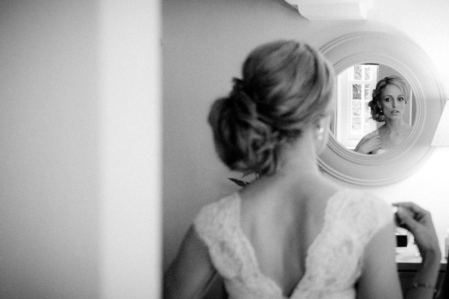 Bride Looking into the mirror at her London wedding
